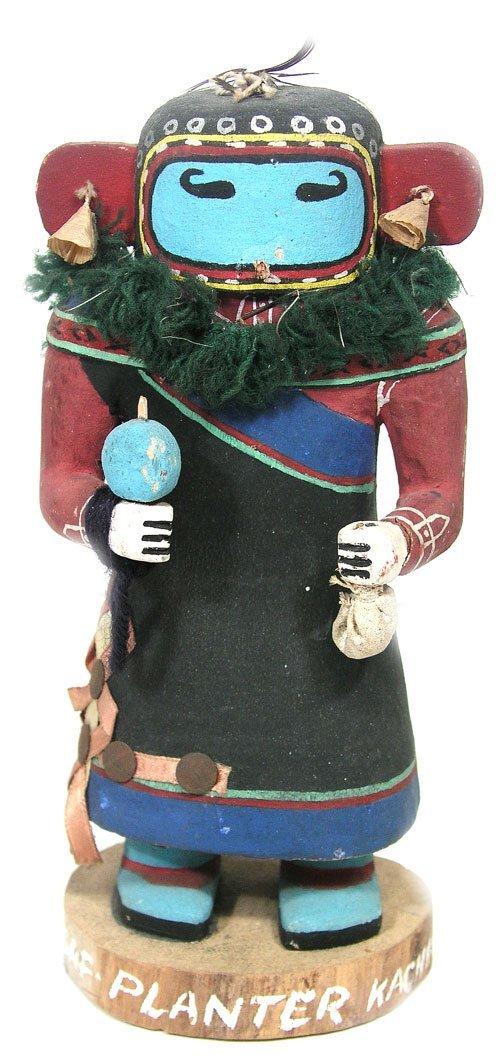 11: Carved Kachina Doll