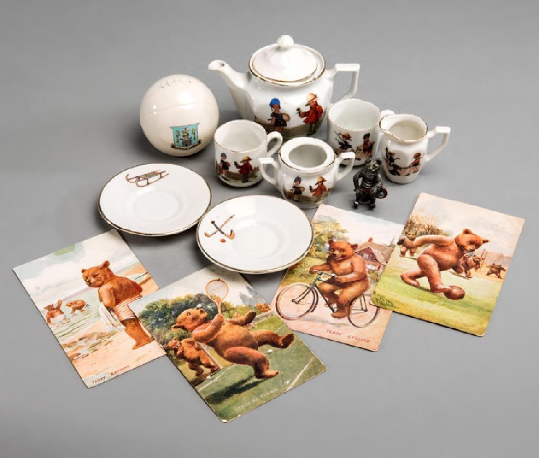 A china nurseryware tea set featuring sports, colour