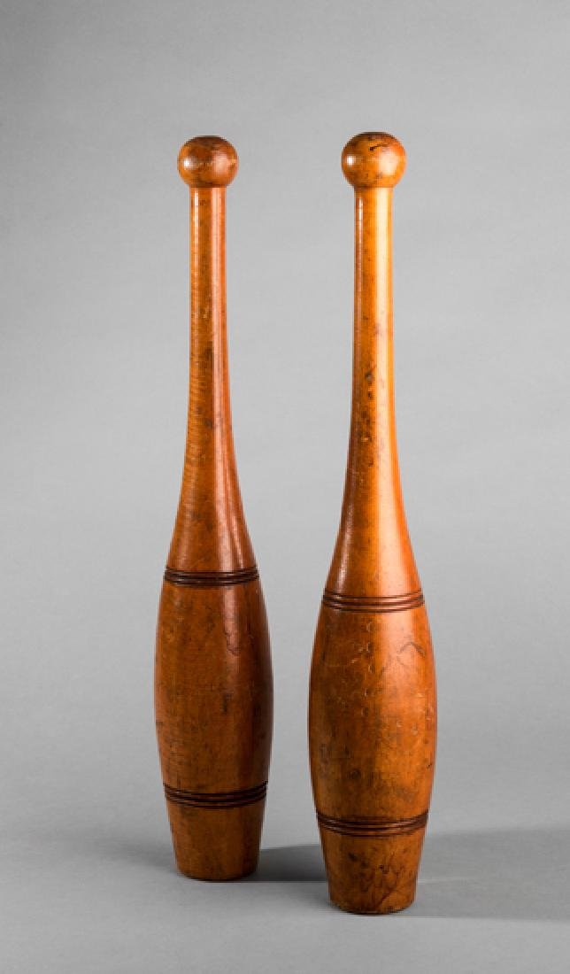 A pair of vintage gymnasium polished wooden Indian