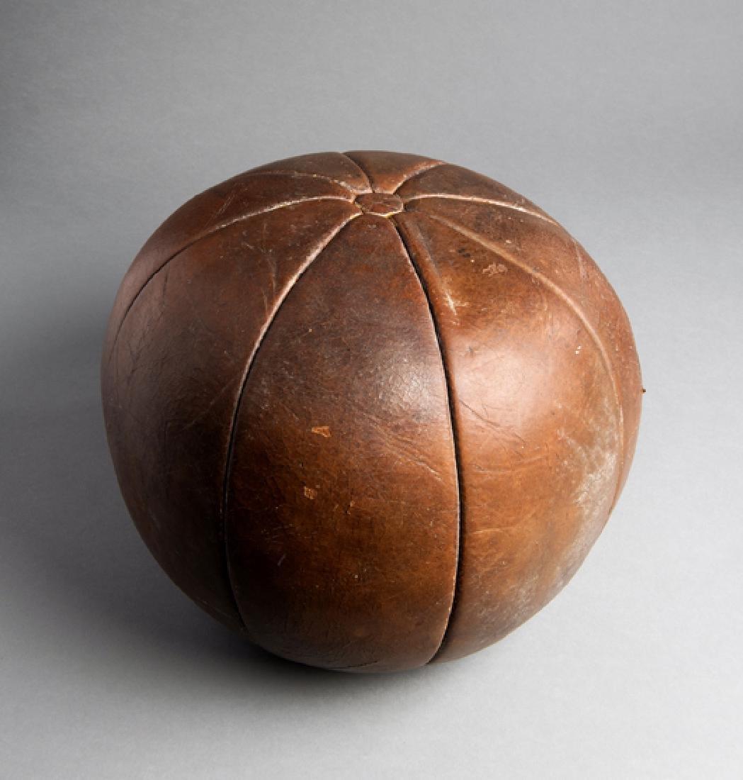 A 19th century leather gymnasium medicine ball, eight