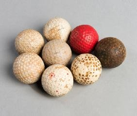 Eight golf balls, including a square-mesh Redwing golf