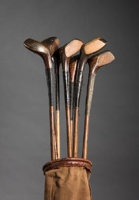 Seven scared-head golf clubs, including a H L Curtis,