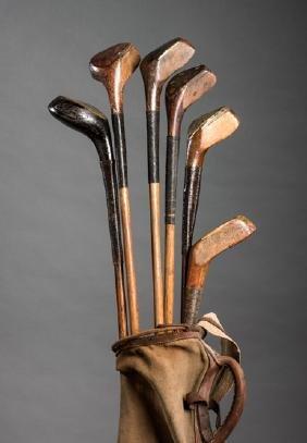 Six scared-head golf clubs, including a Willie Park,