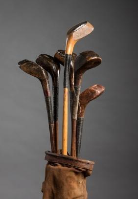 Six scared-head golf clubs, including an A. Robb, Royal