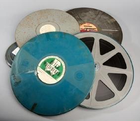 Four original canned cine reels of tennis film, i)