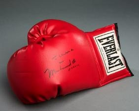 A boxing glove signed by Muhammad Ali and with a