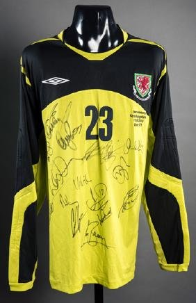 Jason Brown: a team-signed yellow & black Wales No.23