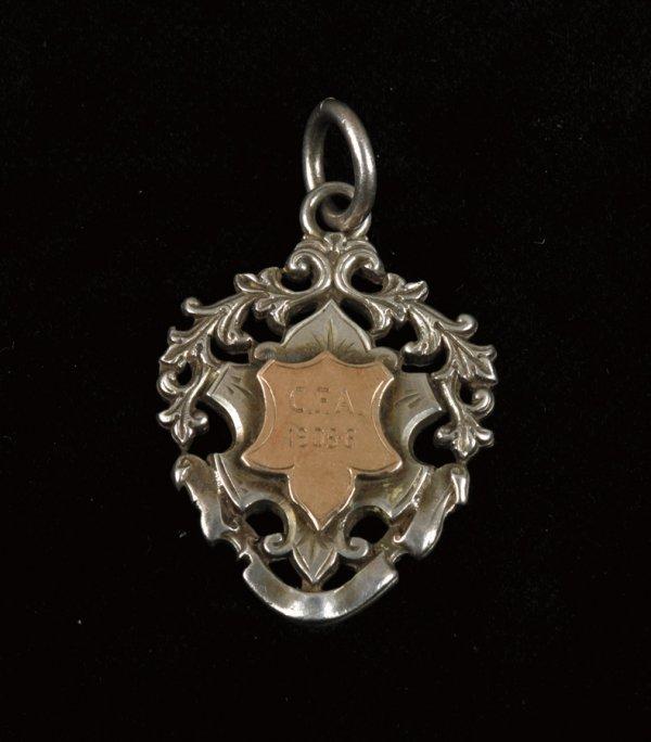 2: A Cambridge Football Association medal won by the le