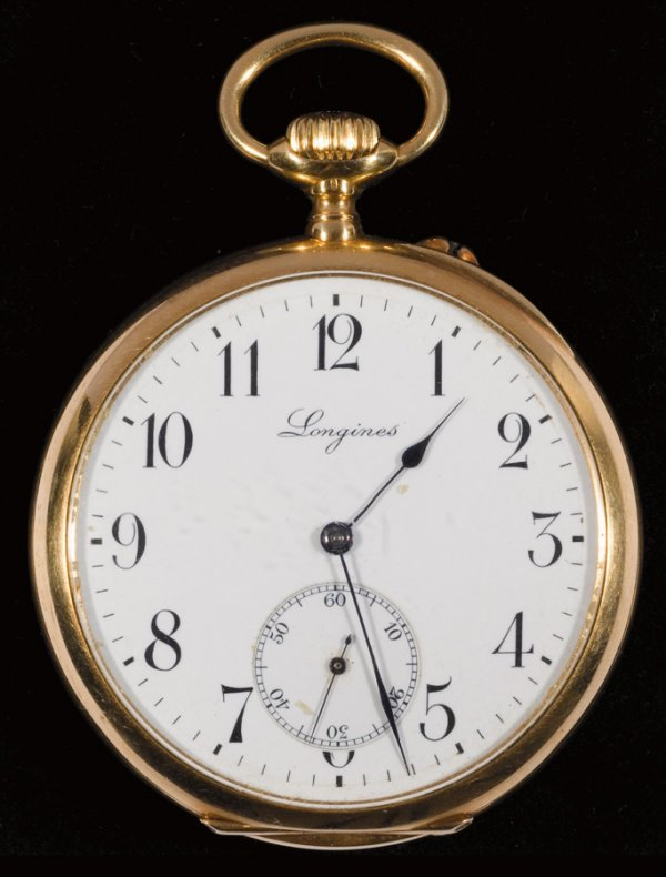 14: An 18ct. gold Longines watch presented to William G