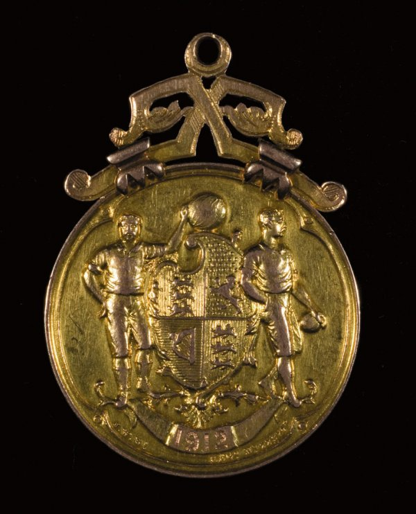 16: A 15ct. gold F.A. Cup winner's medal 1911-12, inscr