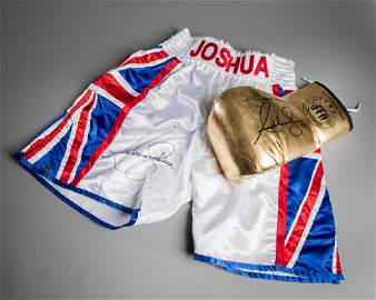 Anthony Joshua signed boxing glove and trunks, a gold