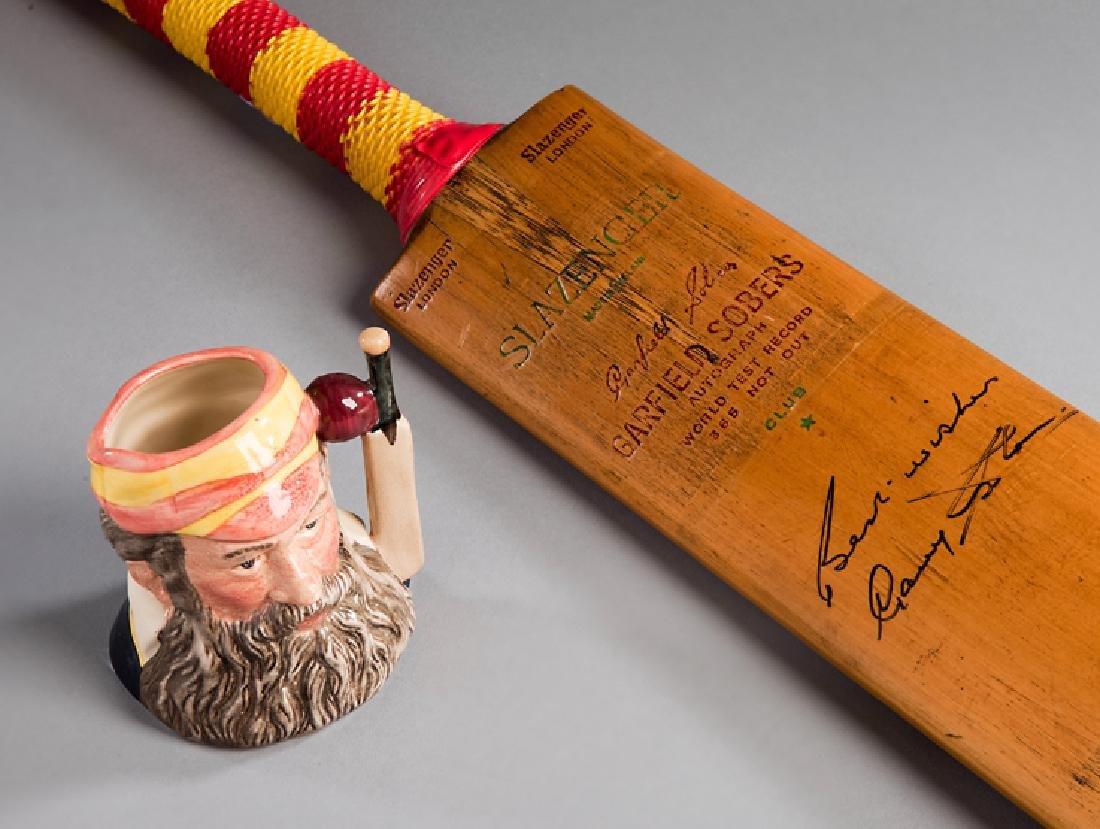 A cricket bat signed by Gary Sobers, a Slazenger