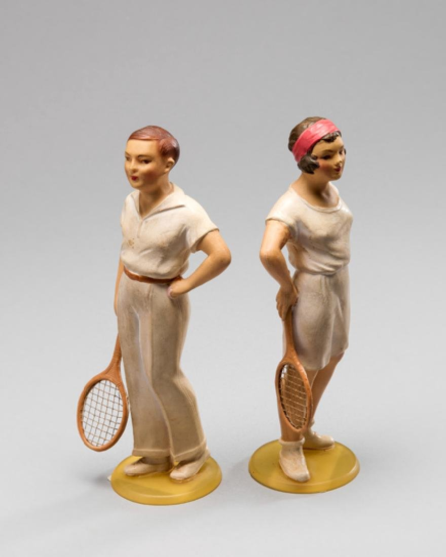 A rare pair of 1930s celluloid figurines of tennis