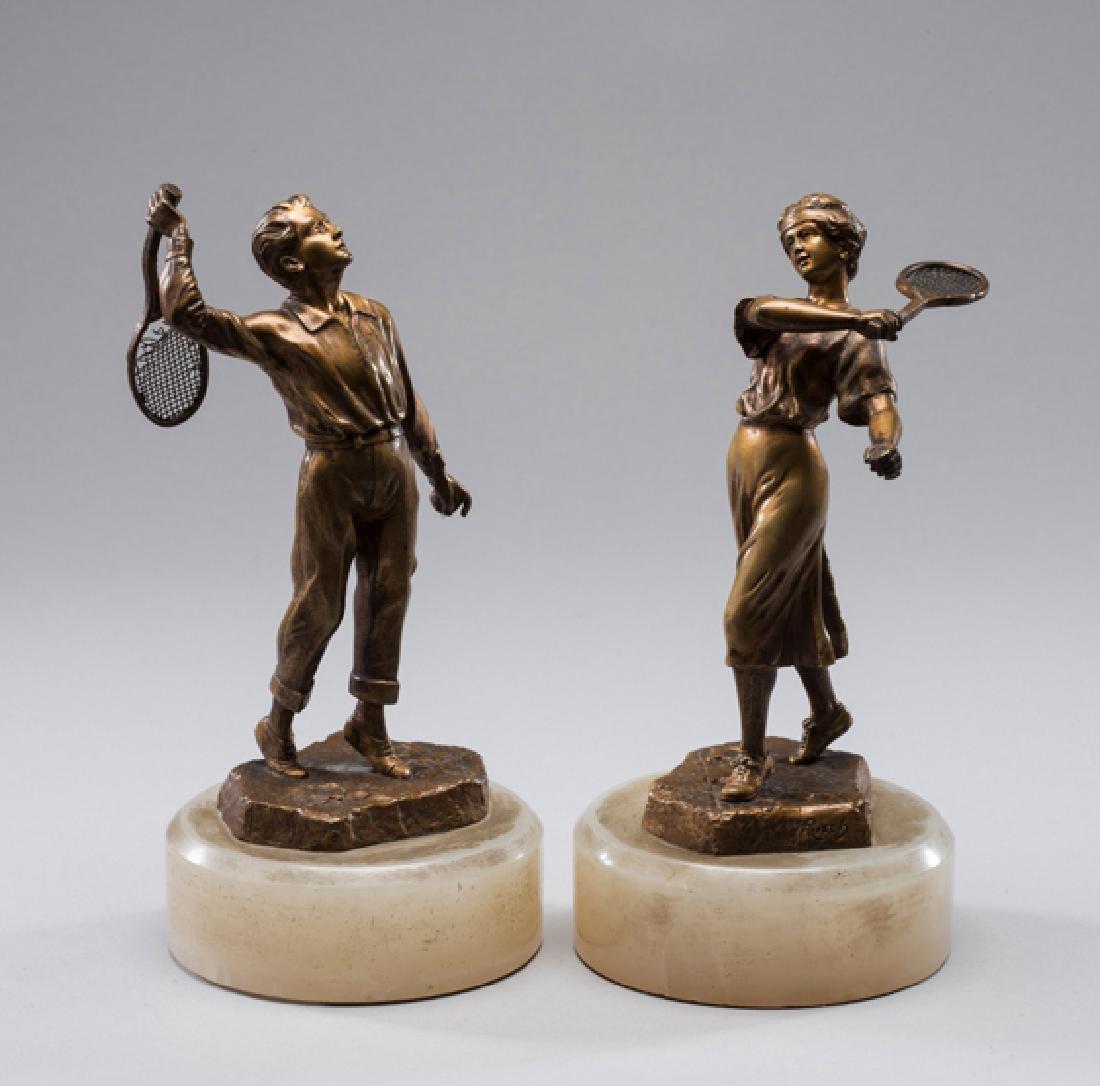 A pair of gilt-bronze figures of tennis players circa