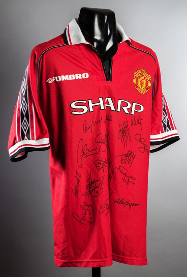 A multi-signed Manchester United 1999 Treble Winners