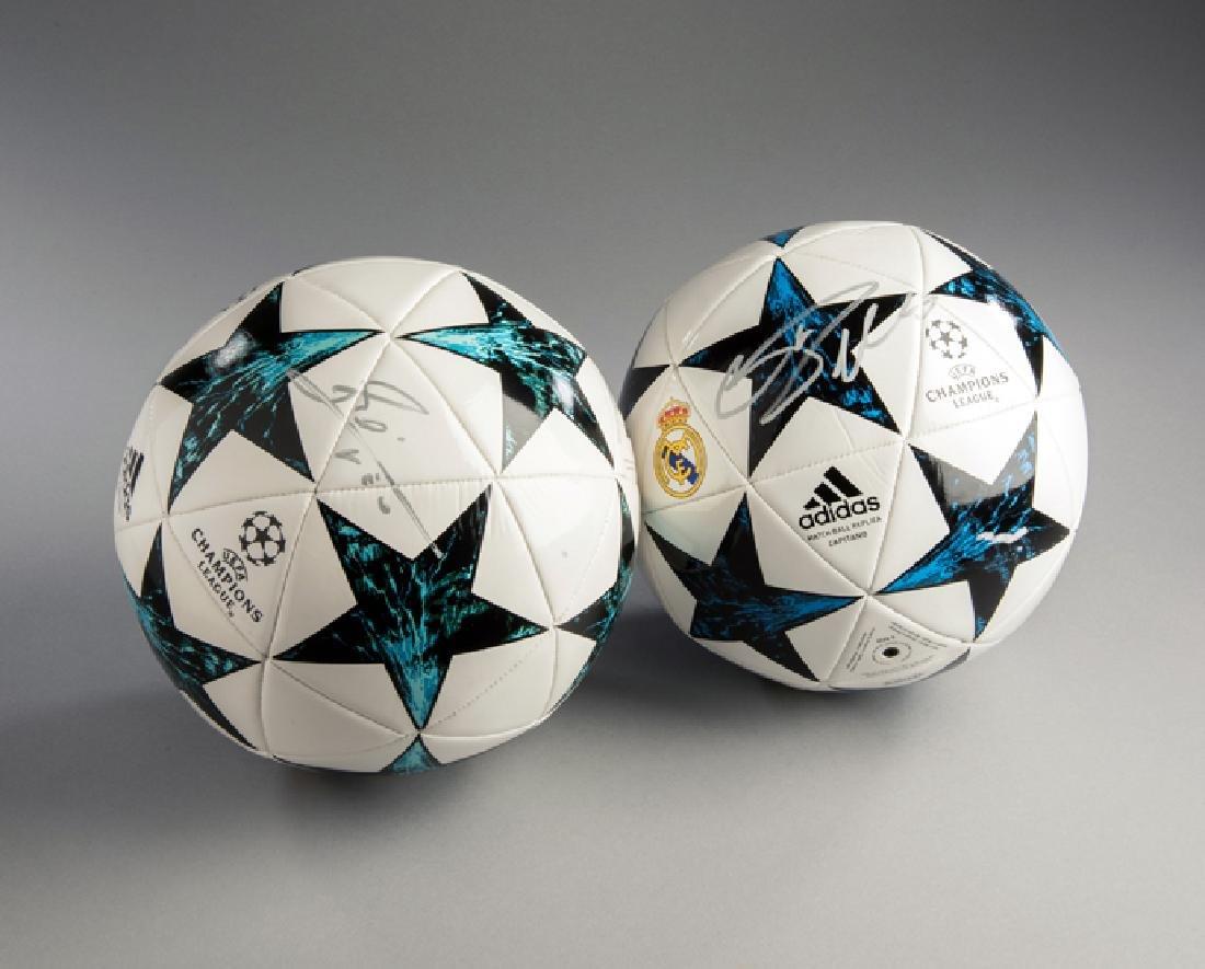 Lionel Messi and Cristiano Ronaldo signed footballs,