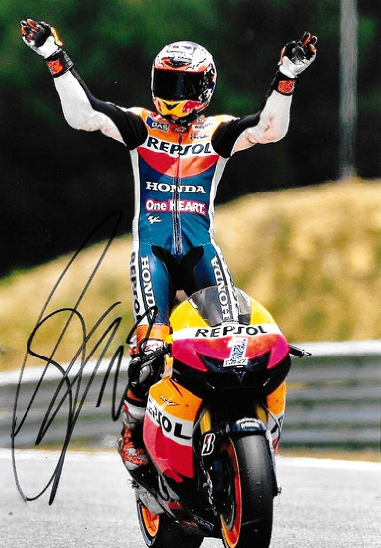 A group of four photographs signed by MotoGP greats - 2