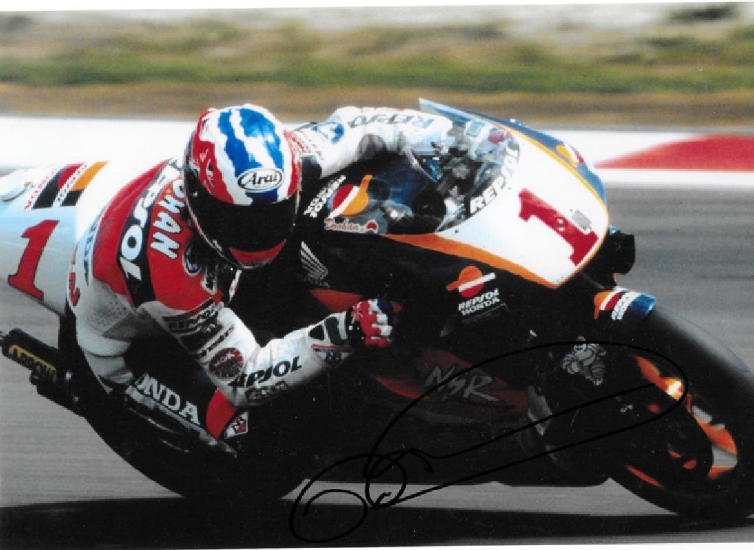 A group of four photographs signed by MotoGP greats - 3