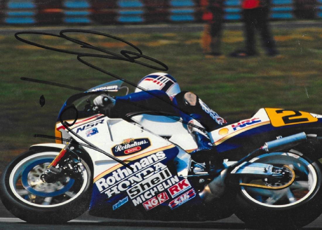 A group of four photographs signed by MotoGP greats - 4