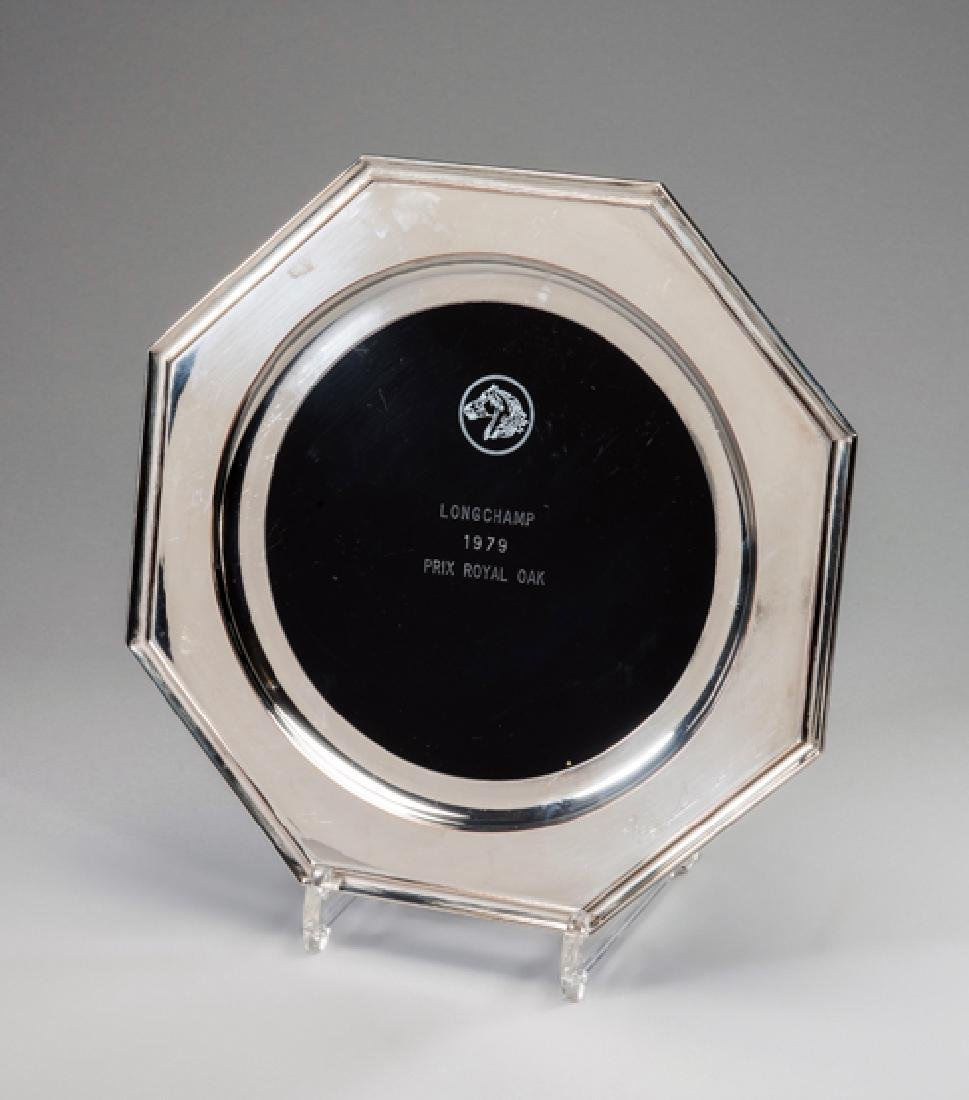The winning trainer's trophy presented to Dick Hern for