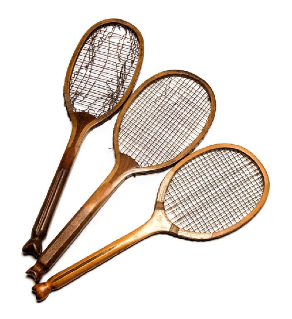 Three fishtail lawn tennis racquets, a Slazenger