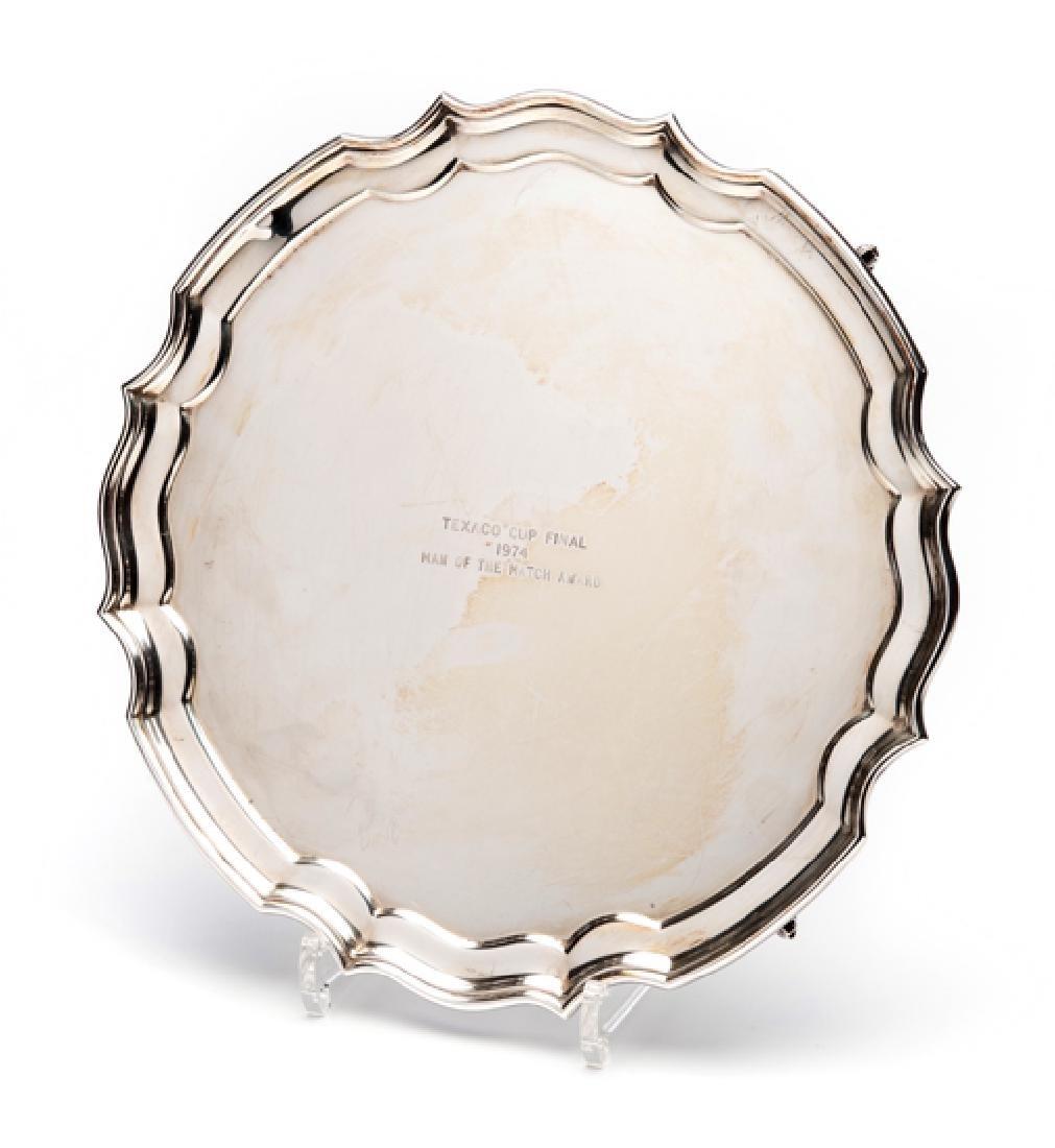 A silver salver presented to Terry McDermott as the