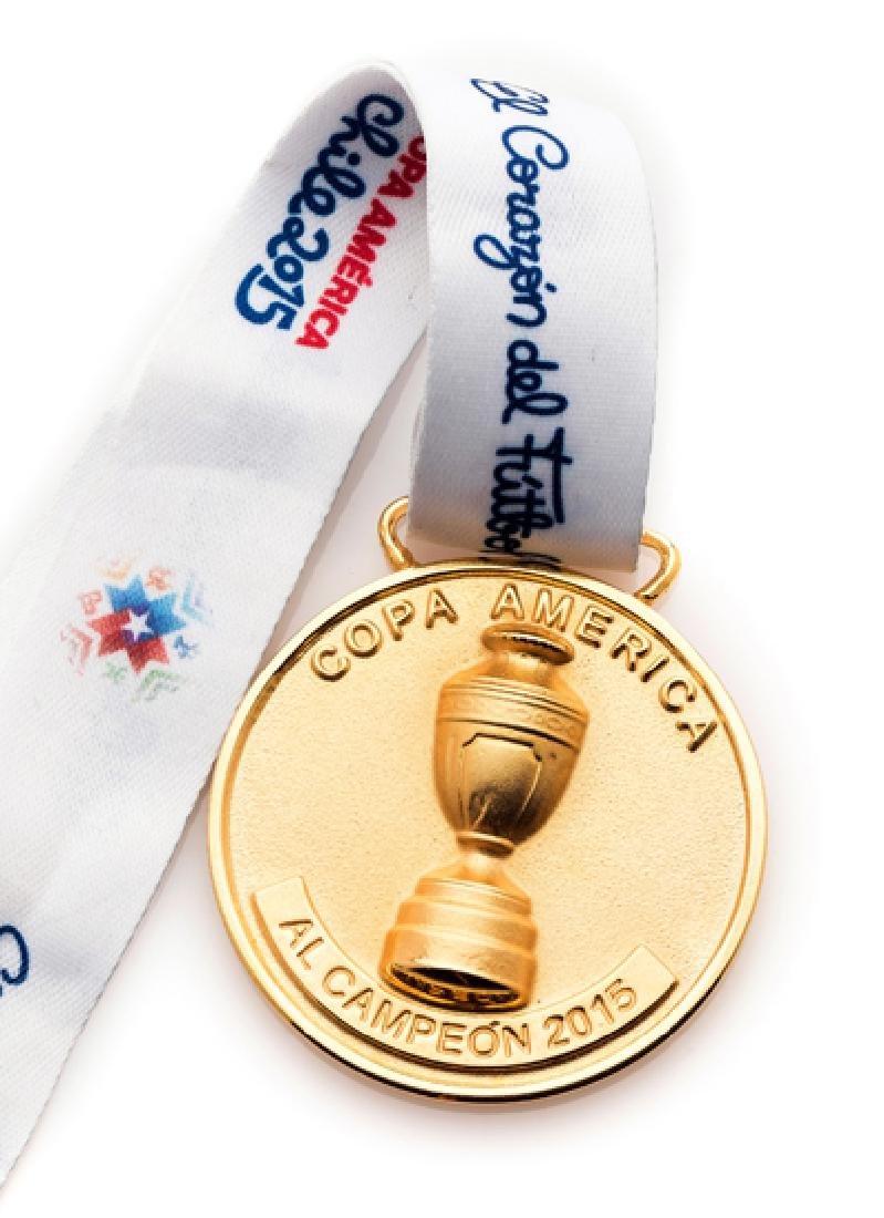 A 2015 Copa America winner's medal, gilt, inscribed