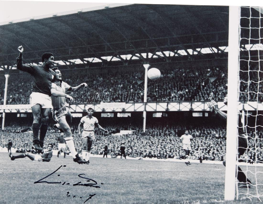 Eusebio signed photograph, large 16 by 12in. b&w at