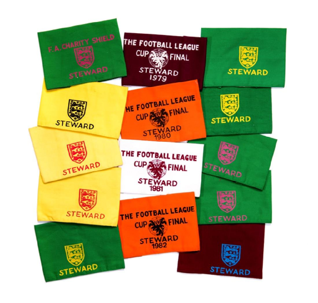 A collection of 14 Wembley Steward's armbands, four