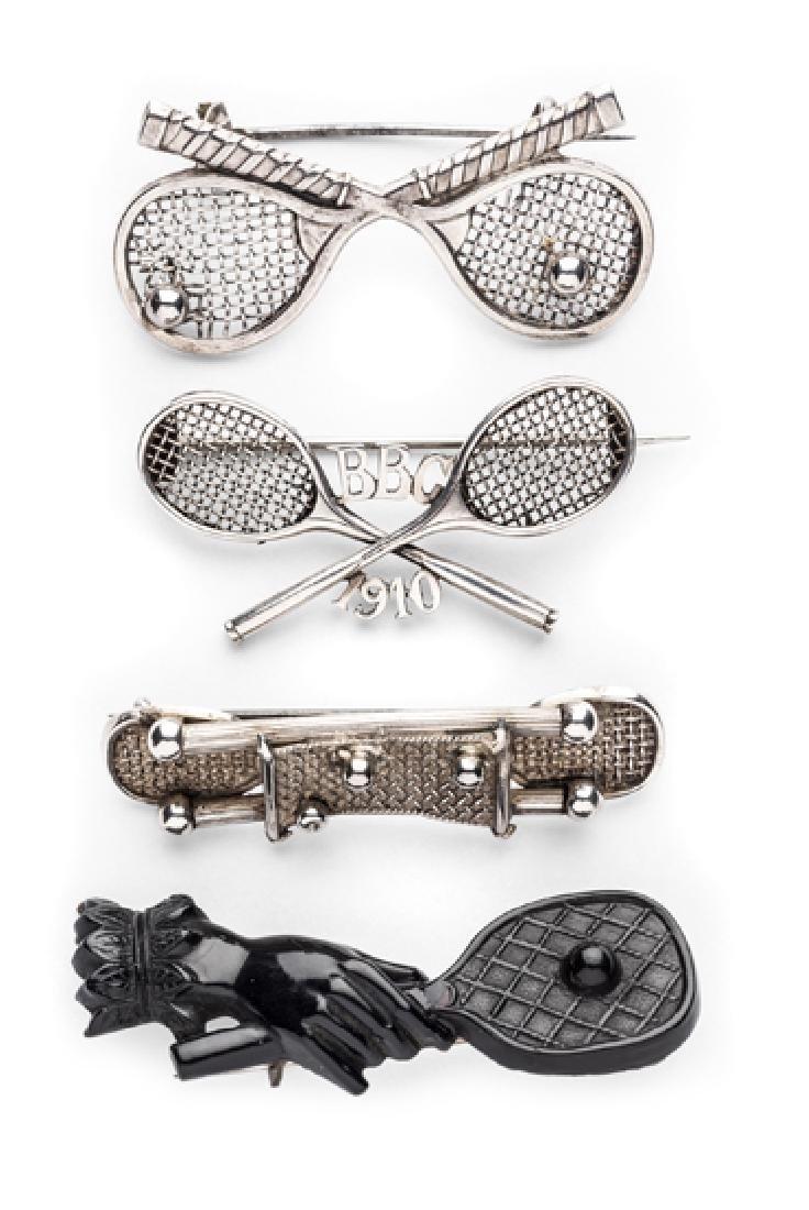 A Victorian Jet hand and tennis racquet brooch, sold