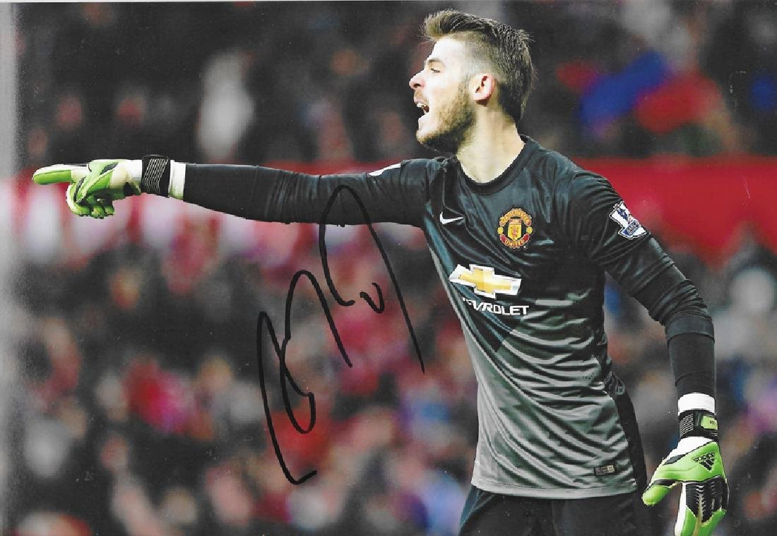 A group of six photographs signed by Manchester United