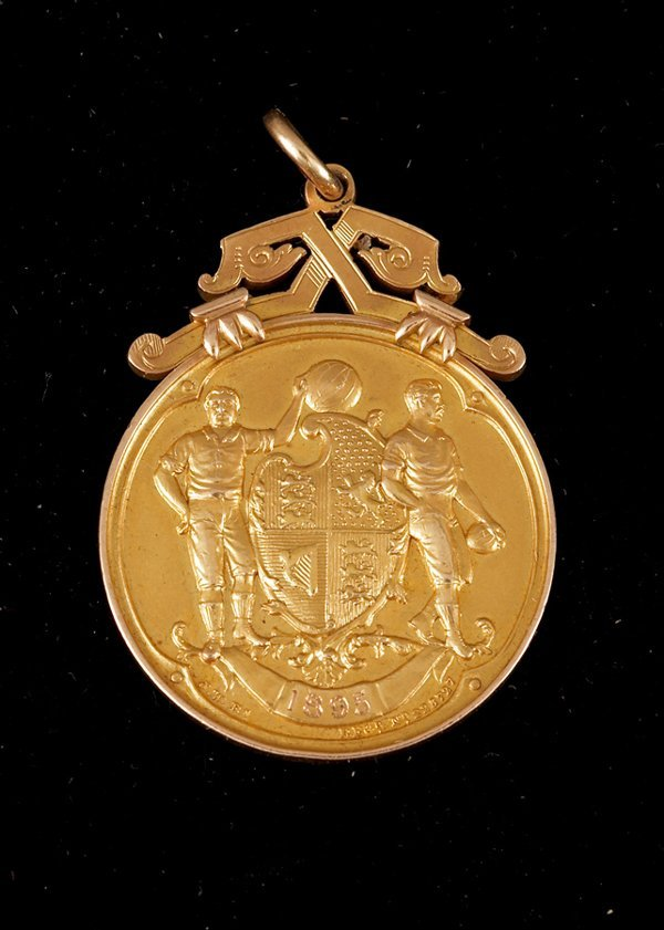 12: A 15ct. gold F.A. Cup winner's medal season 1894-95