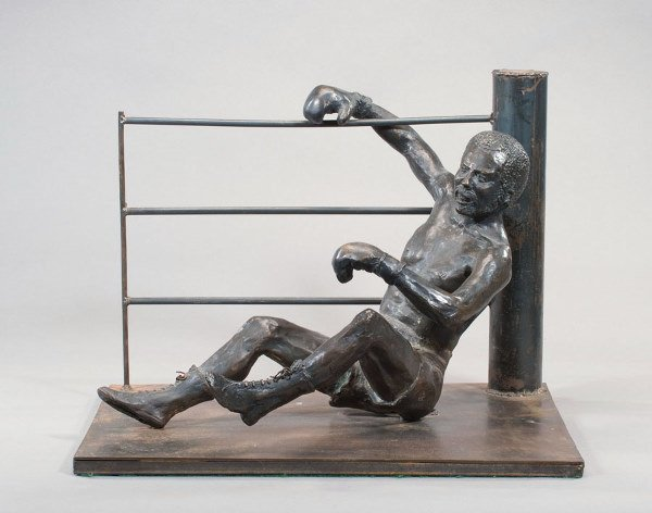 764: A large bronze portraying a boxer on the canvas in