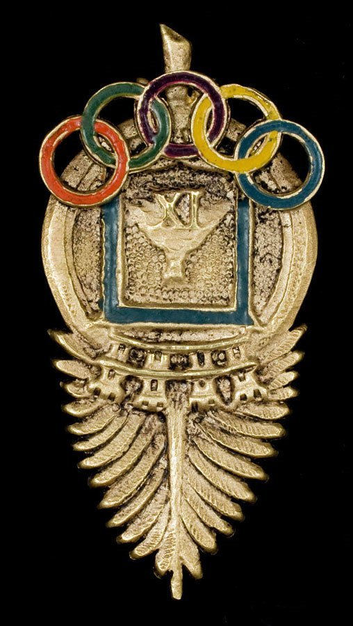 963: An 18ct. gold and enamel lapel badge presented by
