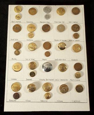 14: A card of 35 gilt-metal hunt buttons, representatio