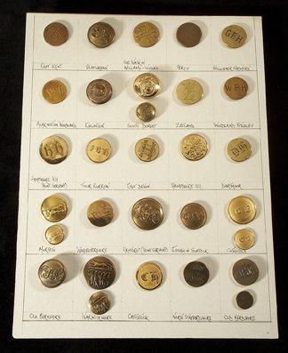 15: A card of 30 gilt-metal hunt buttons, representatio