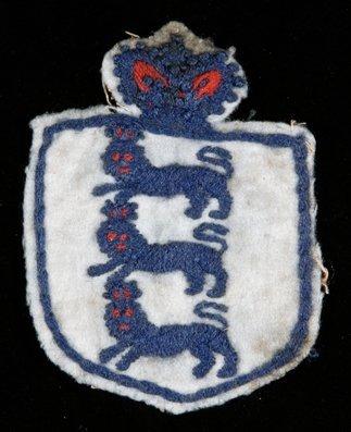 671: A Tommy Crawshaw England international shirt badge