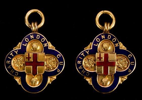 692: Two 9ct. gold & enamel London Charity Cup winner's