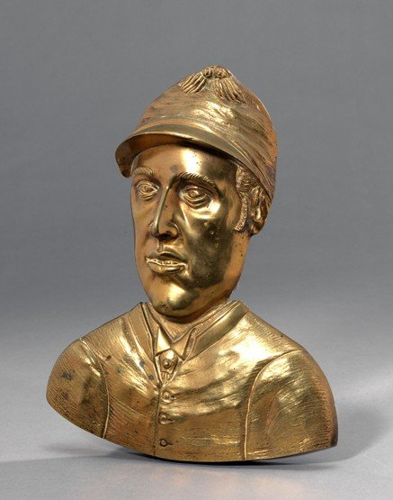 4: A gilt-bronze head & shoulders wall plaque of Fred A
