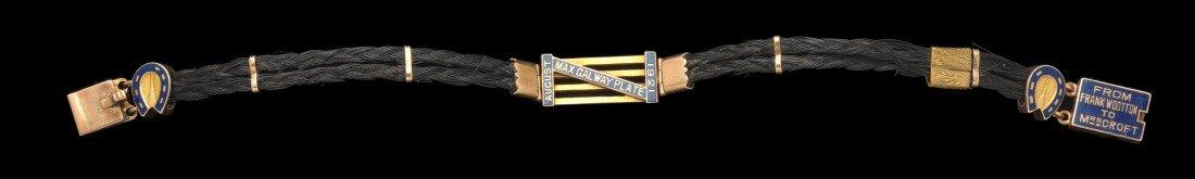 9: A gold, enamel & horse hair bracelet being a gift fr