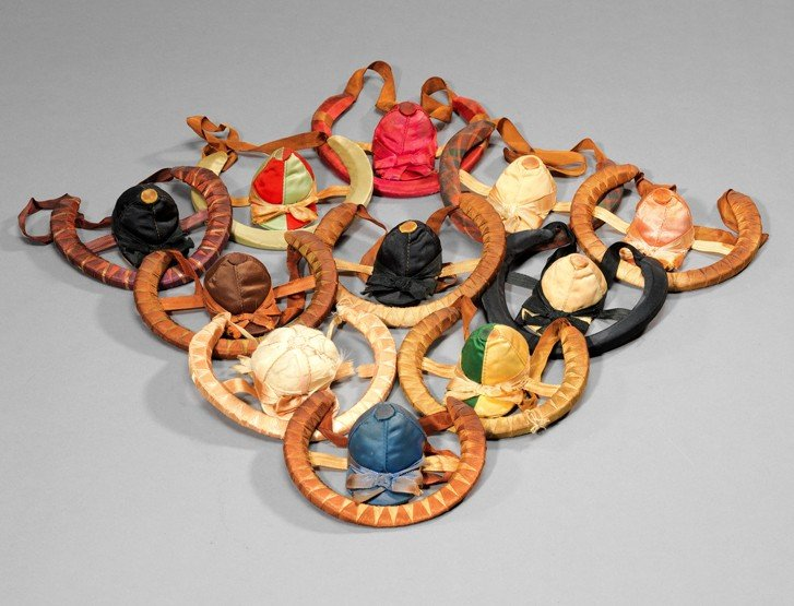 15: A group of 11 commemorative horse shoes dressed in
