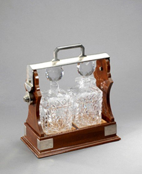21: A mahogany tantalus case with two crystal decanters