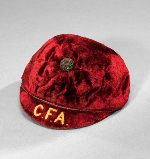 464: A red football cap awarded to C.O.S. Hatton and in