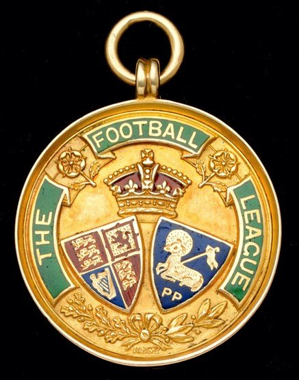 473: A 15ct. gold & enamel Football League Division Two
