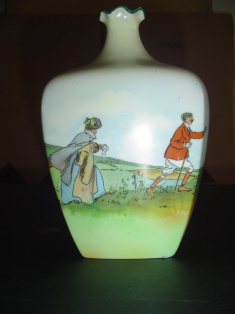 330: A 1920s ceramic vase with golfing scenes signed Br
