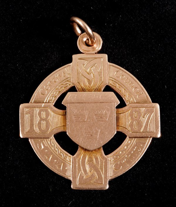 7: Gaelic Football: a 9ct. gold winner's medal from the