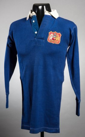 The blue Manchester United No.4 shirt worn by John