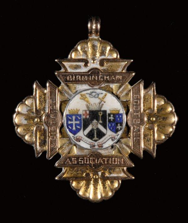 413: An 18ct. gold & enamel Birmingham & District F.A.