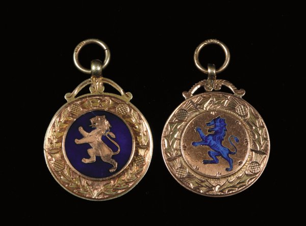 416: Two 9ct. gold and enamel medals, the first inscrib