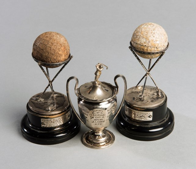 A pair of hallmarked silver Dunlop golf trophies, with